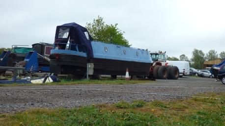 Boat on hardstanding & trailer beyond