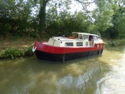 Neat little steel Cruiser(or is it a narrowboat?)
